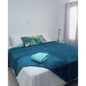 A bed or beds in a room at Sabanilla Hills