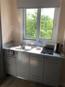 A kitchen or kitchenette at Droushia Heights Apartments