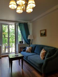 Zona d'estar a Severnaya Venezia Apartment