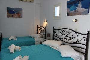 A bed or beds in a room at Spiridoula Villa