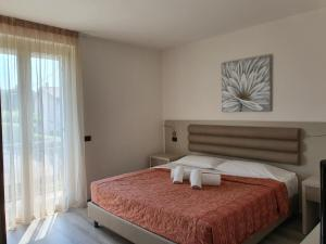 A bed or beds in a room at Residence La Margherita