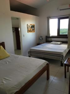 A bed or beds in a room at Casa do Bruno
