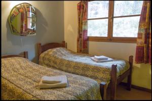Postelja oz. postelje v sobi nastanitve Casa Alihuen