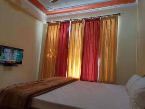 A bed or beds in a room at Green View