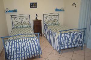 A bed or beds in a room at Le Magnolie