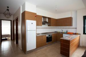A kitchen or kitchenette at Casas Finisterrae Playa