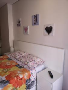 A bed or beds in a room at Hello Braga