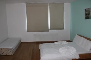 Tempat tidur dalam kamar di Bastabraka Apartments
