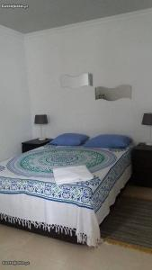 A bed or beds in a room at SHR Houses Algarvia