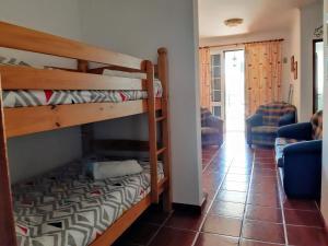 A bunk bed or bunk beds in a room at Refugio das Matas