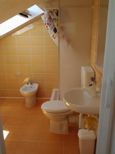 Ванная комната в Apartments Luana