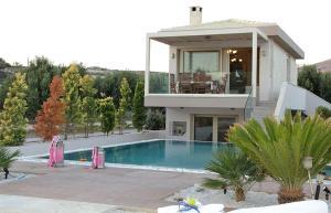 The swimming pool at or near Villa Pelagos