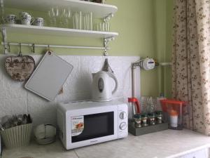 Cucina o angolo cottura di уютная квартира в Петергофе