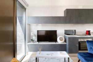 Sjónvarps- og/eða afþreyingartæki á Heart of Camden Two Bedroom Apartment