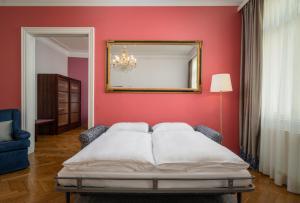 Appartement-Hotel an der Riemergasse tesisinde bir odada yatak veya yataklar