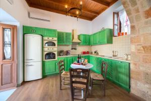 A kitchen or kitchenette at Luxury Villa Eftihia Lindos