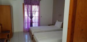 Ένα ή περισσότερα κρεβάτια σε δωμάτιο στο Σπίτι Όνειρο