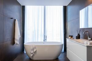 A bathroom at Shenkin Apartments by Master