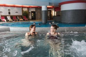 The swimming pool at or near CGH Résidences & Spas Les Clarines