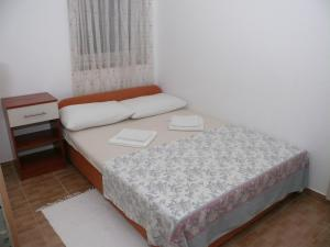 A bed or beds in a room at Apartments Panonija