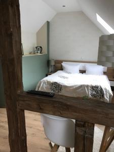 Een bed of bedden in een kamer bij Historische Mühle Vogelsang