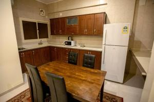 A kitchen or kitchenette at Raha Hotel Suites