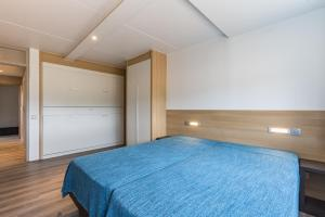 Een bed of bedden in een kamer bij Vakantie Domein Ter Helme