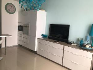 A television and/or entertainment center at Premiera Apartments