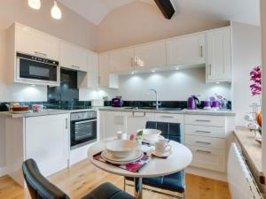 A kitchen or kitchenette at Holiday Home Gandil