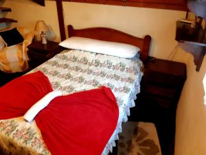 A bed or beds in a room at Chalé Luar da Montanha