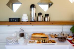 Η κουζίνα ή μικρή κουζίνα στο Locanda Barbati Luxury ApartHotel