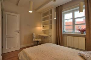 Ein Bett oder Betten in einem Zimmer der Unterkunft Royal Warsaw Apartment