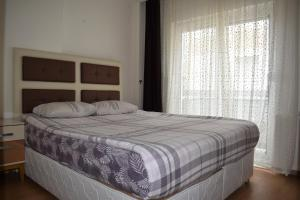 A bed or beds in a room at Bypegasus Smart Flats