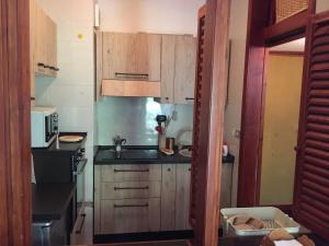 Cucina o angolo cottura di Delizioso appartamento in residence