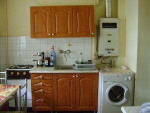 A kitchen or kitchenette at Pannónia Vendégház