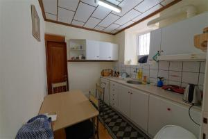 A kitchen or kitchenette at Kavala Rooms