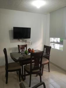A television and/or entertainment center at Apartamento Vacacional