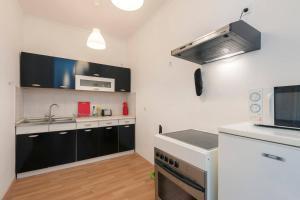 Kuhinja ili čajna kuhinja u objektu Porat Apartments