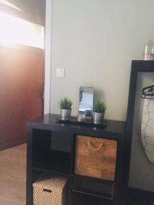 A television and/or entertainment center at Apartment Easyway to sleep
