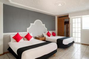 Capital O Hotel y Spa Posada Mirador