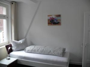 A bed or beds in a room at Ferienwohnung Speyer
