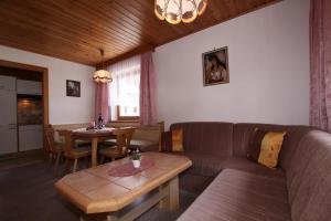 A seating area at Landhaus Tschafein