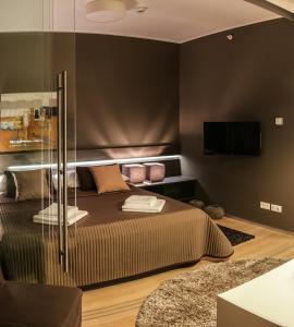 Łóżko lub łóżka w pokoju w obiekcie Wenceslas Square Terraces