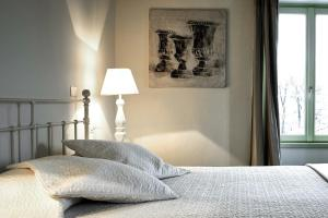 A bed or beds in a room at Porta Nuova Bergamo Apartments