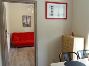 A seating area at Sopot City Apartament