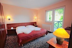 Krevet ili kreveti u jedinici u okviru objekta Terme Olimia - Aparthotel Rosa