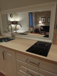 A kitchen or kitchenette at The Guest House II