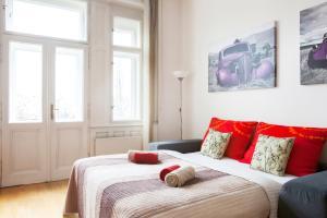 Кровать или кровати в номере Riverview Apartments Prague
