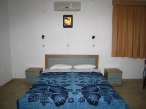Ένα ή περισσότερα κρεβάτια σε δωμάτιο στο Eleftheria Studios