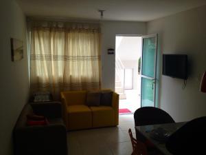 A seating area at Flat Porto dos Carneiros